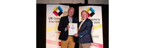Nick Kirby of Swanline Print receiving the SPA Supplier Gold Award from Tim Gray, Chairman of SPA